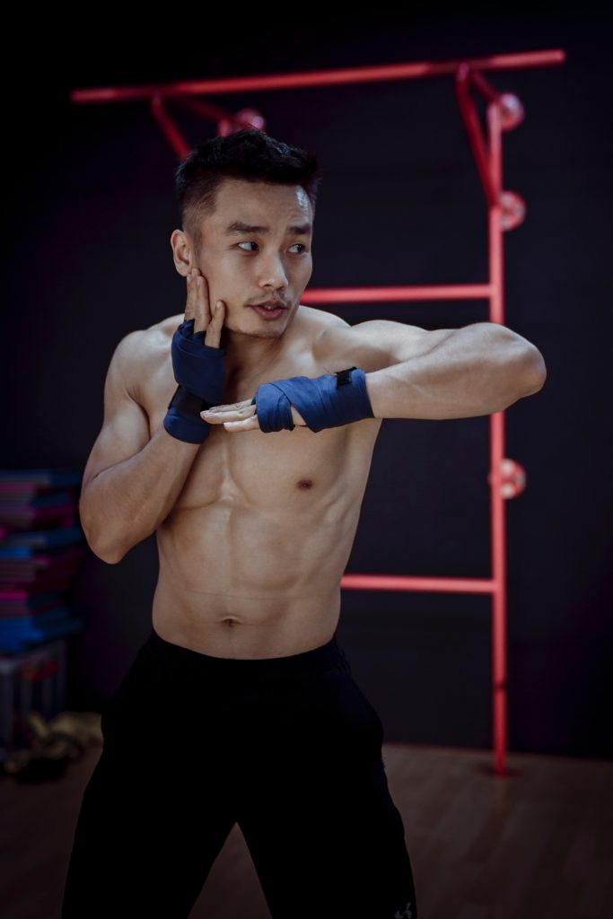 photo-of-topless-man-wearing-blue-gloves-Martial Arts