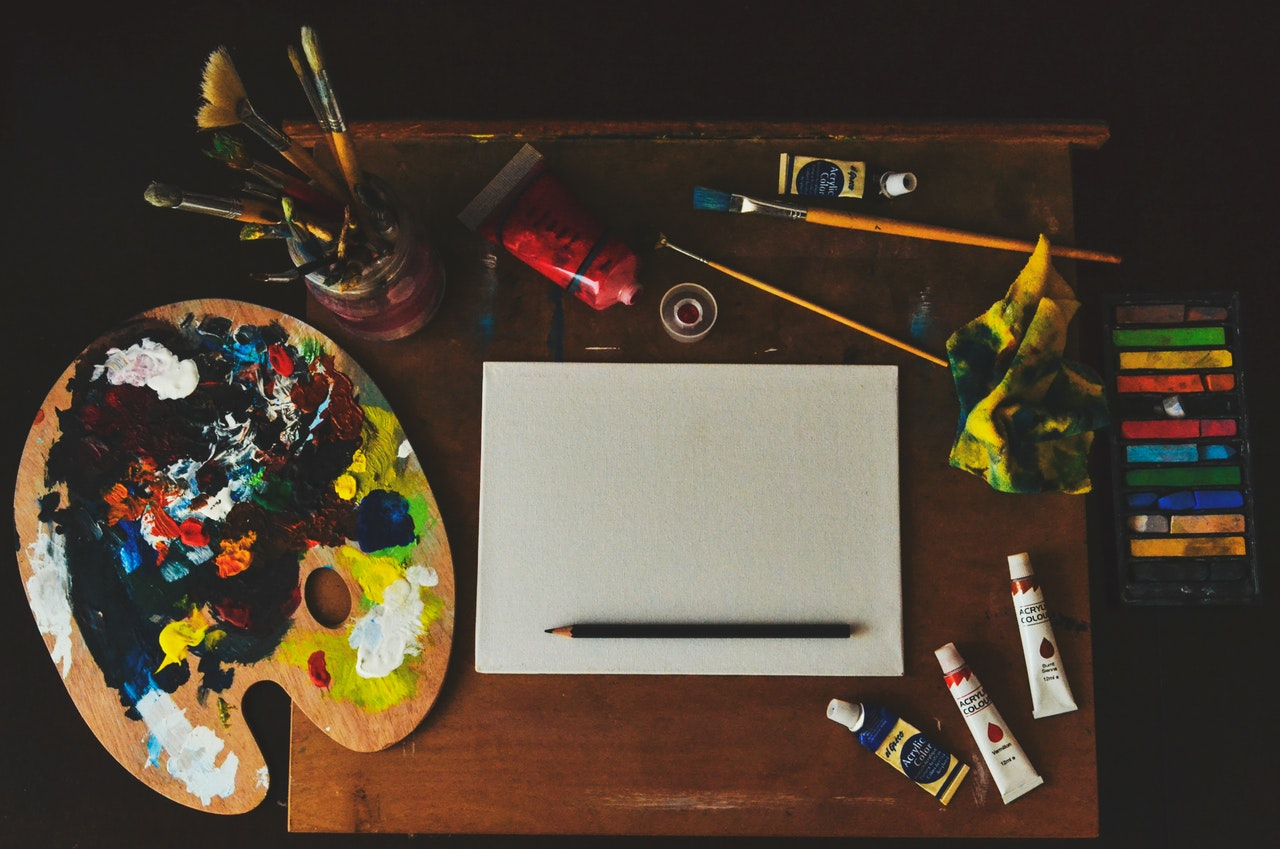 painting as a hobby, painting set on a table.