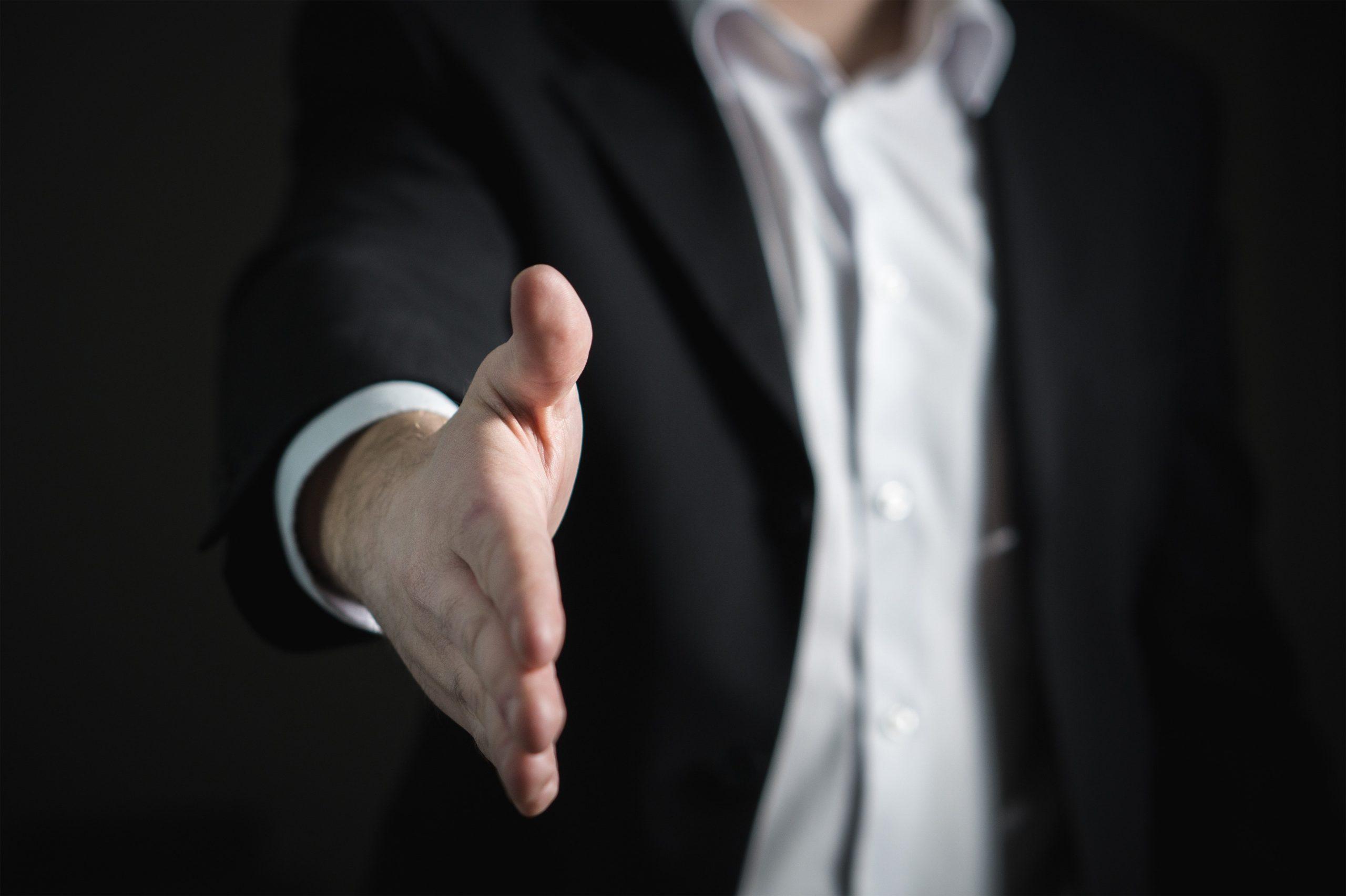 A man extending handshake