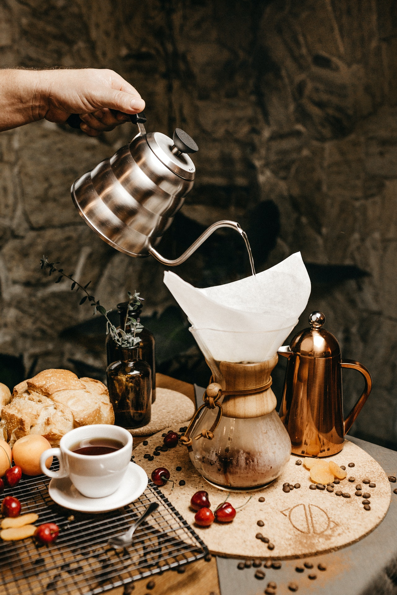 A set up of tradition drip over the cup coffee maker