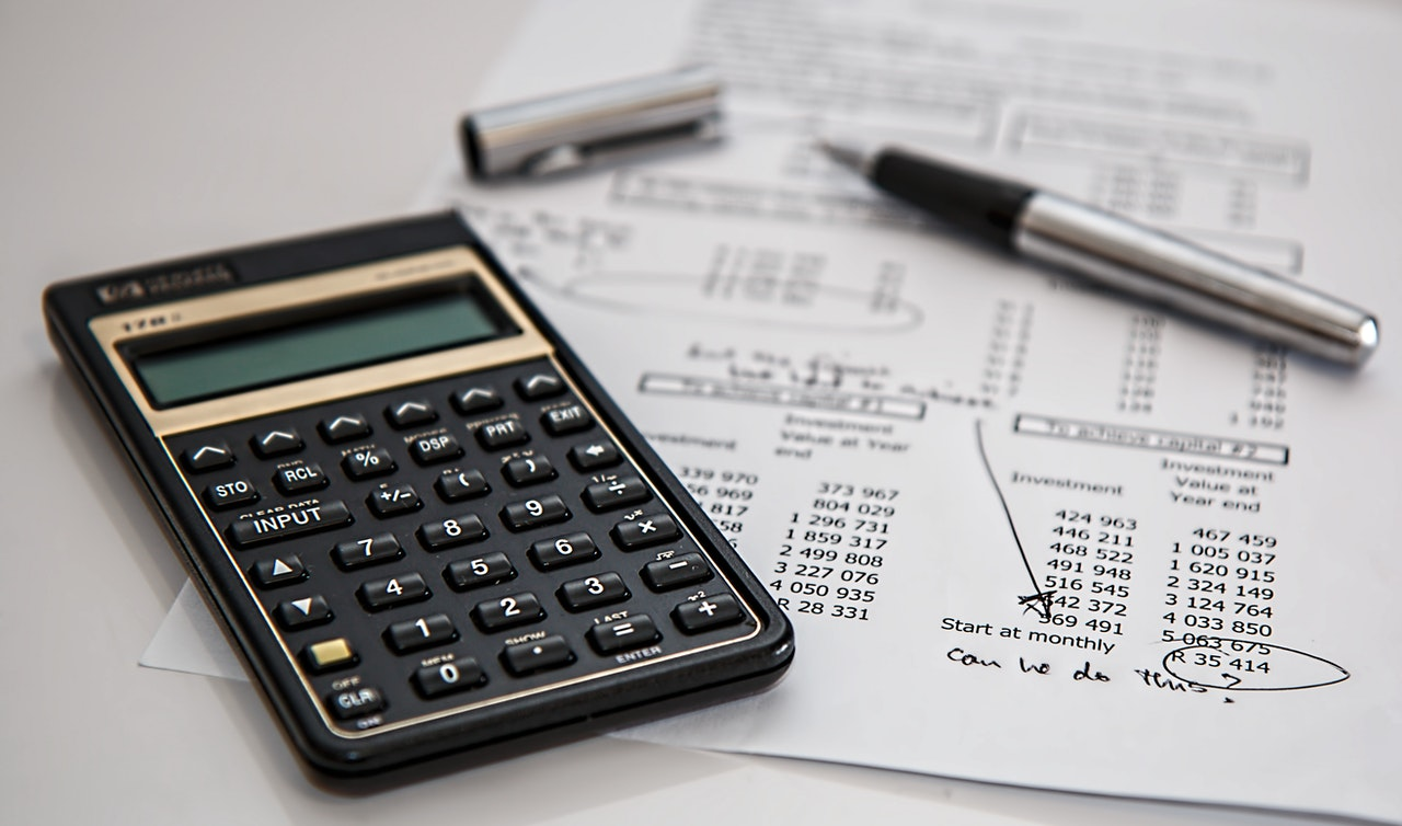 A calculator, paper and pen. For calculating finance.